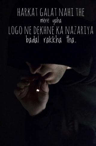 man in hoodie smoking cigarette 1047319
